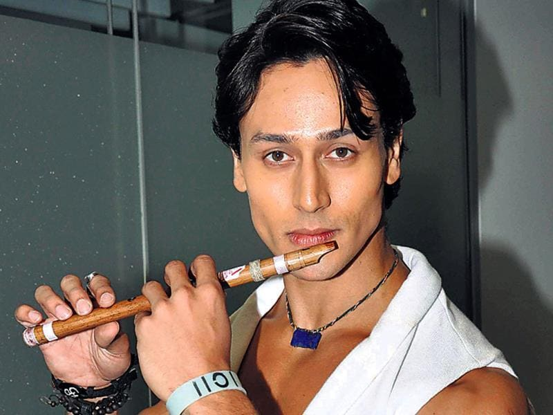 Tiger Shroff poses with a flute at a film event. We wonder if the actor can play the instrument as well.