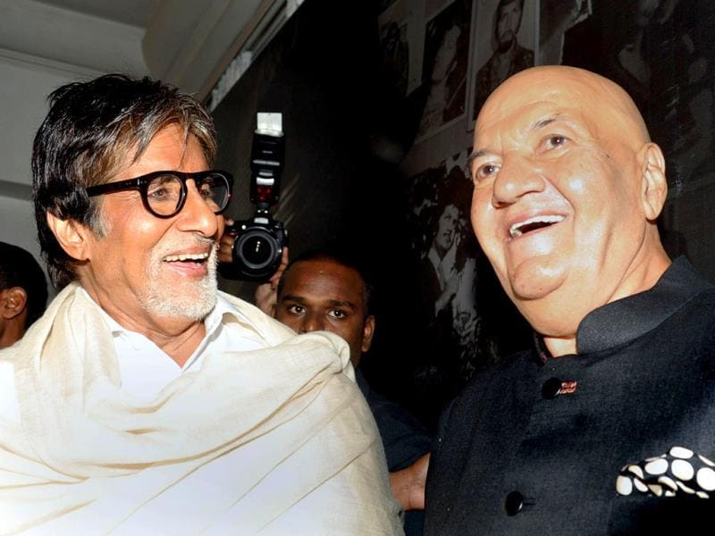 Bollywood actor Prem Chopra shares a light moment with fellow actor Amitabh Bachchan during the launch of his biography Prem Naam Hai Mera written by his daughter Rakita Nanda in Mumbai. (AFP)