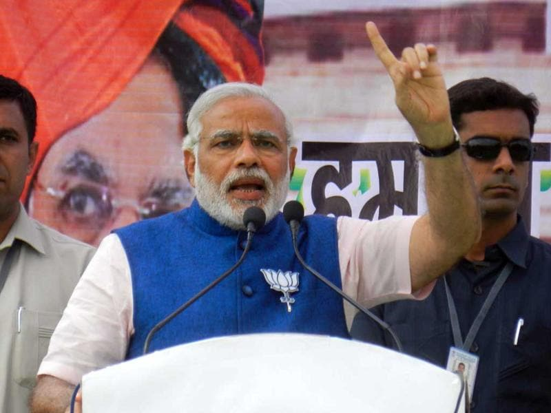 BJP Prime Ministerial candidate Narendra Modi addresses a public rally in Lakhimpur. (Shadab Raza/ HT photo)