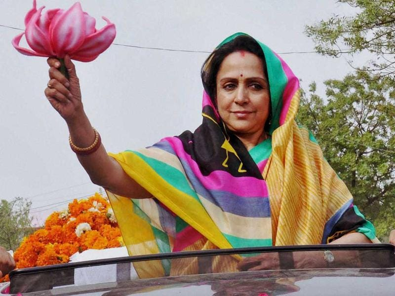 Actress and BJP candidate Hema Malini during an election campaign in Mathura. PTI Photo