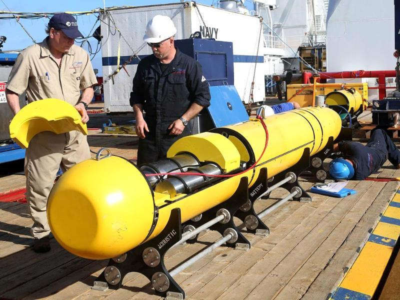 Phoenix International workers Chris Minor (R) and Curt Newport inspect the US Navy's Bluefin 21 autonomous underwater vehicle (AUV) before deployment in the southern Indian Ocean to look for the missing Malaysia Airlines flight MH370 in this handout picture released by the Australian Defence Force. (Reuters)