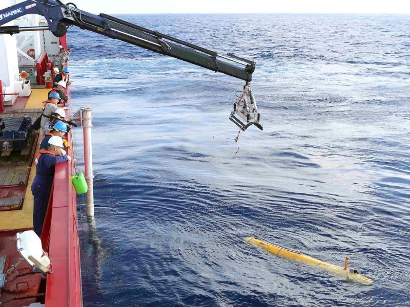 Crew aboard the Australian Defence Vessel Ocean Shield watch as the US Navy's Bluefin-21 autonomous underwater vehicle (AUV) is deployed in the southern Indian Ocean to look for the missing Malaysian Airlines flight MH370 in this handout picture released by the Australian Defence Force. (Reuters)