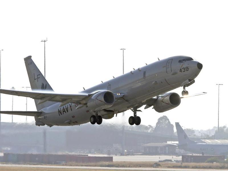 A US Navy P8 Poseidon takes off from Perth Airport en route to rejoin the ongoing search operations for missing Malaysia Airlines Flight MH370 in Perth, Australia. (AP photo)