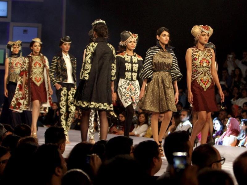 Models display designer Akif Mahmood's works at a fashion show in Lahore. (AP Photo)