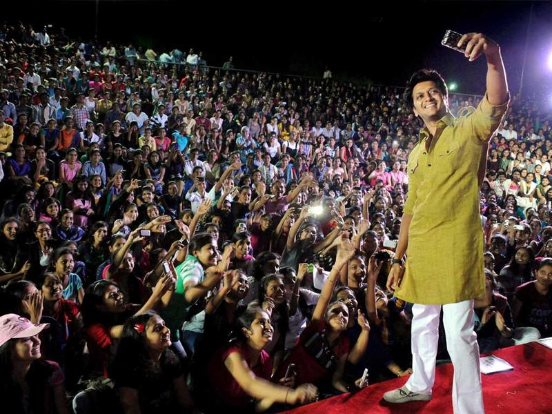 Bollywood actor Ritesh Deshmukh interacts with youth in support of Congress candidate Dattatray Bansode at Nana Nani park, in Latur, Maharashtra. (PTI Photo)