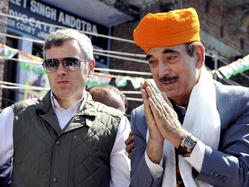 Union minister and Congress candidate Ghulam Nabi Azad with Jammu and Kashmir chief minister Omar Abdullah at a roadshow after filing his nomination papers in Kathua. (PTI Photo)