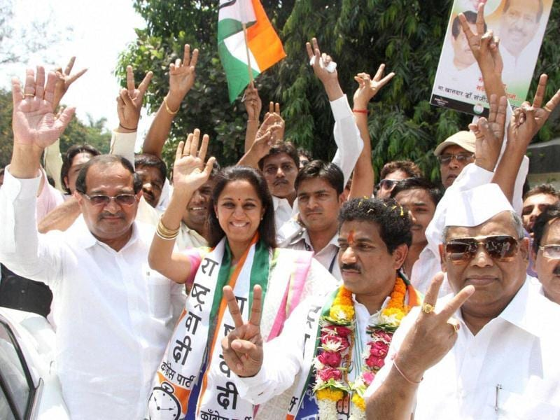 NCP candidate Sanjeev Naik along with NCP leaders Supriya Sule and other party workers during a roadshow in Thane, Maharashtra. (PTI Photo)