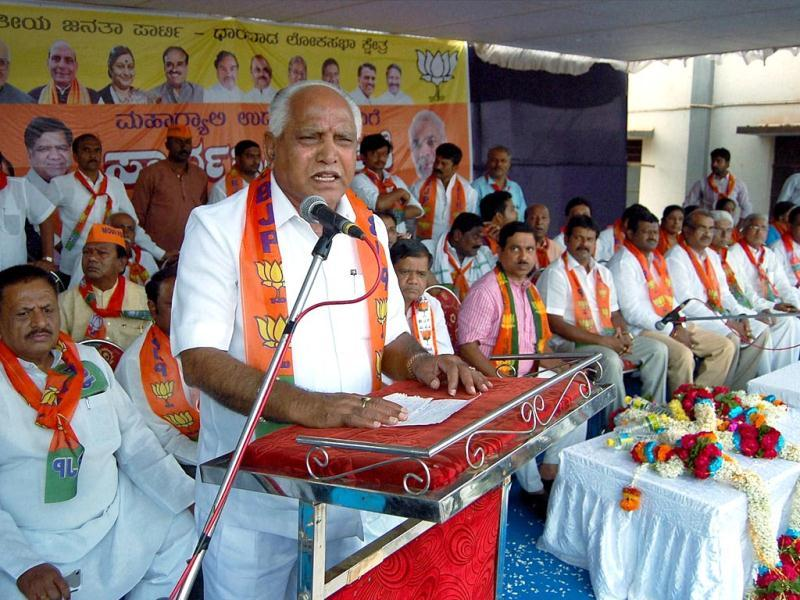 Former Karnataka CM BS Yeddyurappa addressing an election campaign meeting for party candidate from Dharawad Lok Sabha seat at Moorusvira Math in Hubli. (PTI Photo)