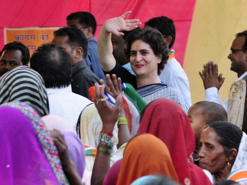 Priyanka Gandhi Vadra waves during her public meeting for giving final touch to Sonia Gandhi poll campaign in Raebareli. (HT photo/Deepak Gupta)
