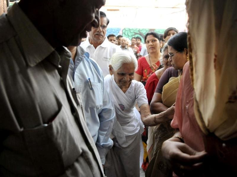 An elderly woman arrives for voting in the fifth phase of Lok Sabha polls in Bhopal. (HT photo)