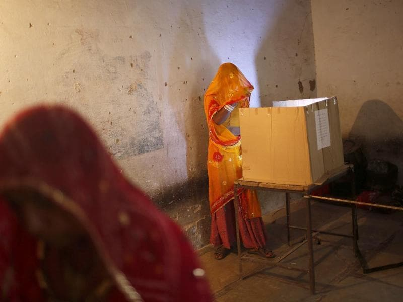 A woman casts her vote at a polling station in Ajmer district in the desert Indian state of Rajasthan. (Reuters)