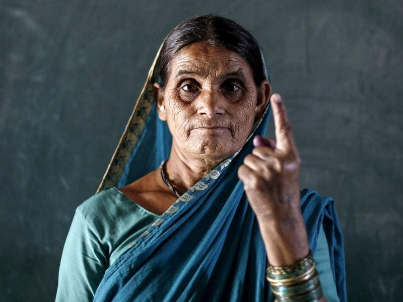 A woman shows her ink-marked finger after voting inside a polling station in the village of Kamshet, in Maharashtra. (Reuters)