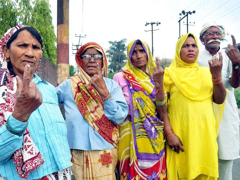 Women voters show their ink marked fingers after casting votes for Lok Sabha elections in Moradabad, Uttar Pradesh on Thursday. (PTI Photo)