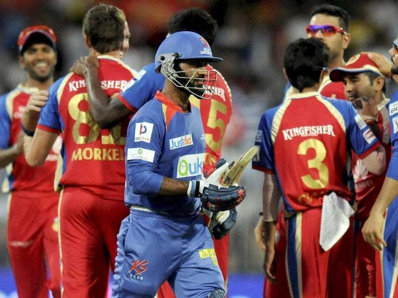 Dinesh Karthik of the Delhi Daredevils walks back after getting out during their IPL 7 match against the Royal Challengers Bangalore being held at the Sharjah Cricket Stadium in Sharjah. (PTI Photo)