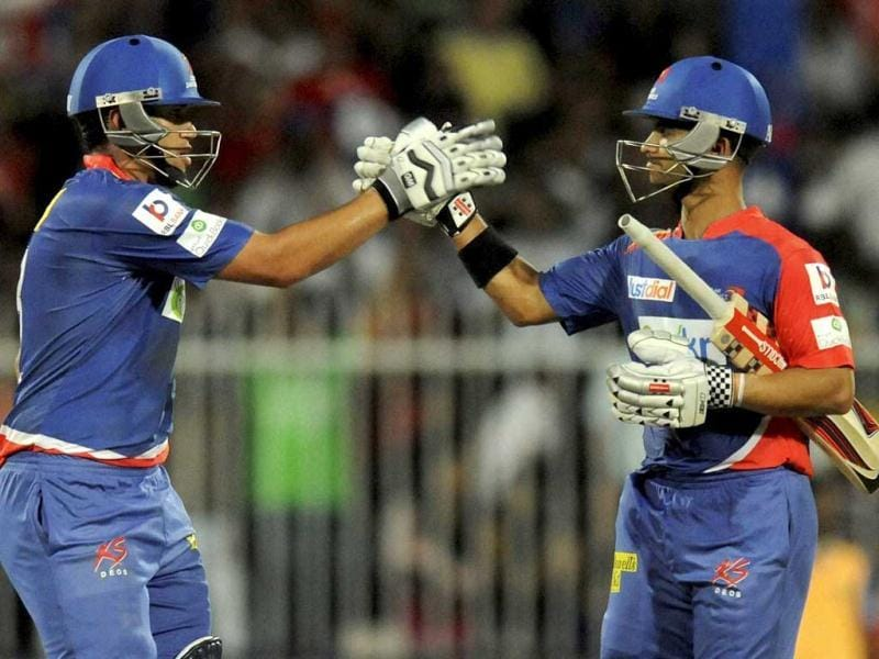 Delhi Daredevils' Ross Taylor and JP Duminy celebrate after the first innings against Royal Challengers Bangalore during the IPL 7 being held at the Sharjah Cricket Stadium, Sharjah. (PTI Photo)
