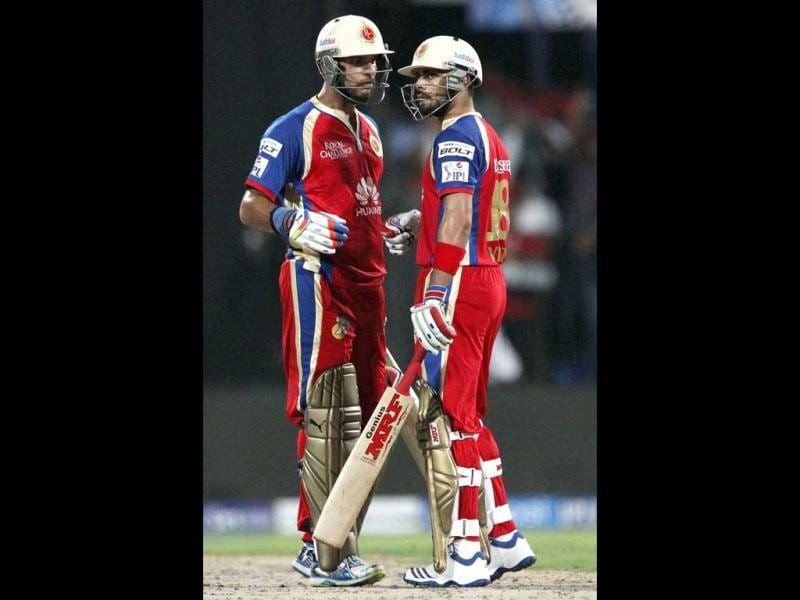 Yuvraj Singh and Virat Kohli of the Royal Challengers Bangalore exchange a word during their IPL 7 match against Royal Challengers Bangalore being held at the Sharjah Cricket Stadium in Sharjah. (PTI Photo)
