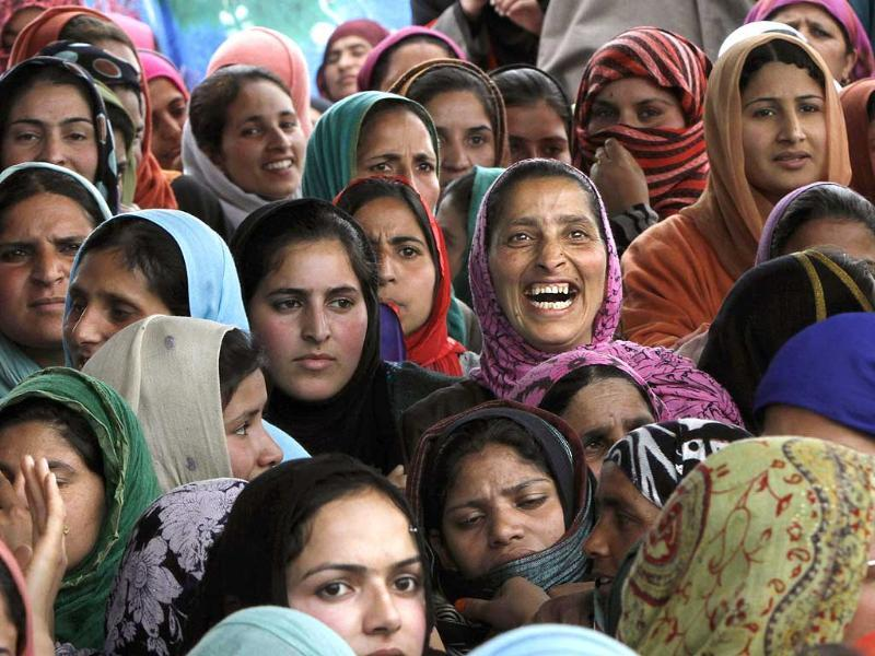 A Kashmiri woman supporter of the Peoples Democratic Party (PDP) attends an election campaign rally on the outskirts of Srinagar. (AP photo)