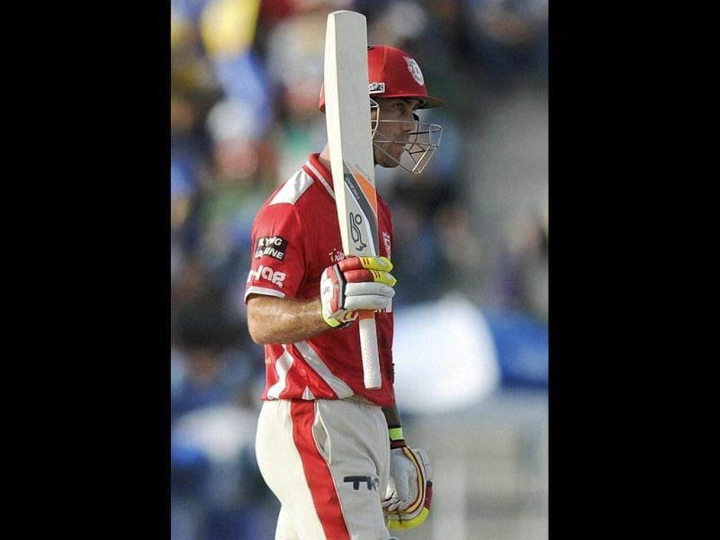 Glenn Maxwell of Kings XI Punjab raises his bat after scoring a half century during their IPL 7 match against Chennai Super Kings at the Al Zayed Cricket Stadium, Abu Dhabi. (PTI Photo)