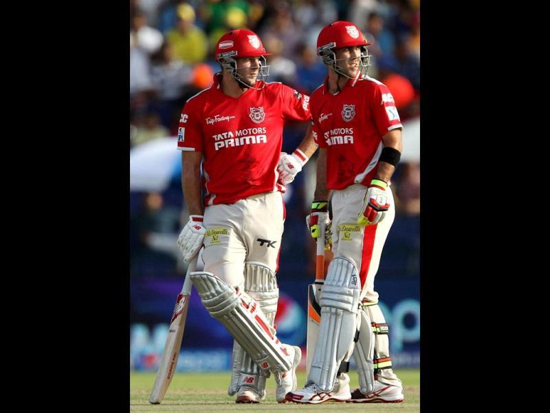 David Miller and Glenn Maxwell of Kings XI Punjab in action during their IPL 7 match against Chennai Super Kings at the Al Zayed Cricket Stadium, Abu Dhabi. (PTI Photo)