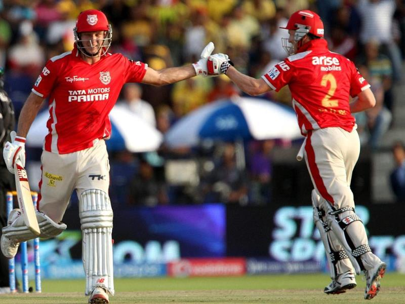 George Bailey of Kings XI Punjab celebrates the win with David Miller during their IPL 7 match against Chennai Super Kings at the Al Zayed Cricket Stadium, Abu Dhabi. (PTI Photo)