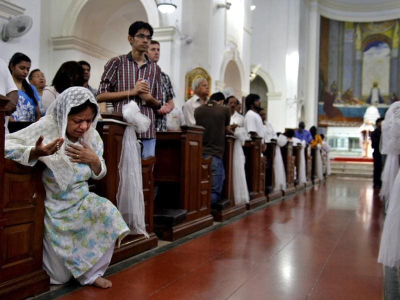 People are busy in prayer at Sacred Heart Cathedral church during Good Friday ceremony in New Delhi. (HT photo/Subrata Biswas)
