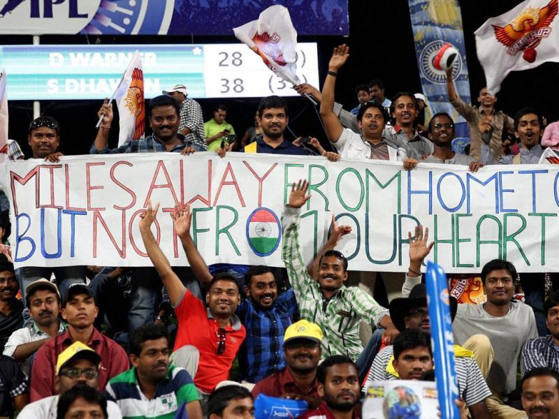 Fans watch a IPL 7 match between Sunrisers Hyderabad and Rajasthan Royals in Abu Dhabi. (PTI Photo)