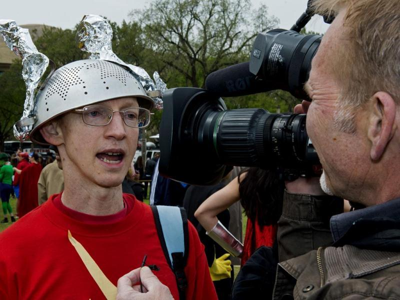 David Gayer, from Silver Spring, MD, wears a colander strainer as a helmet for his Flash costume at Awesome Con 2014 in Washington. (AFP photo)