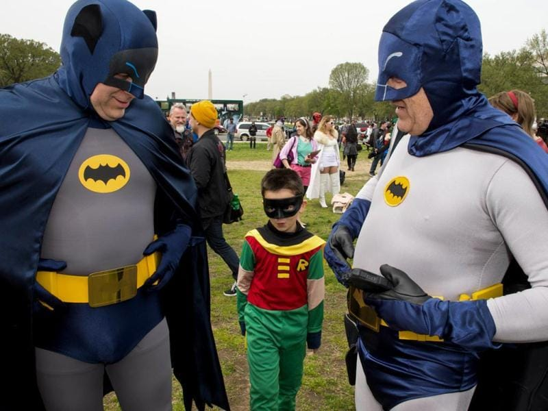 People dressed in superhero-style costumes line up for a photo at the Awesome Con 2014 in Washington. (AFP photo)