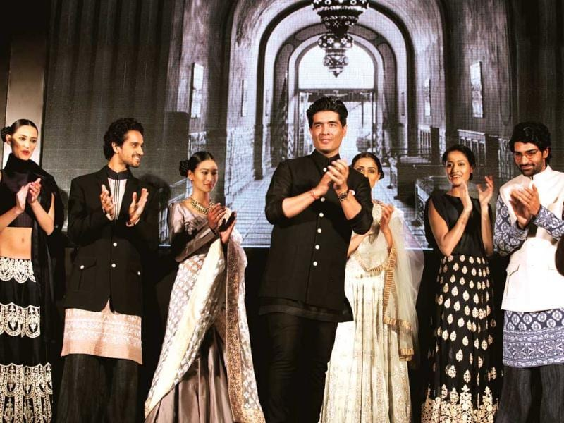 Designer Manish Malhotra with his models after an exclusive showcase of his Mijwan collection.