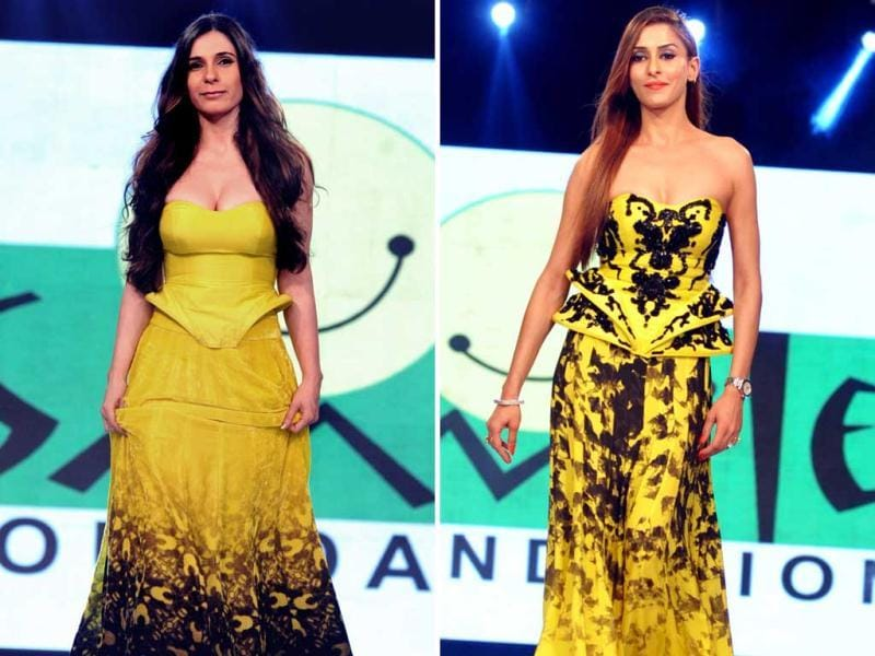 Former VJ Ramona Arena (left) and television actress Shilpa Saklani showcase a creation by designer Ken Ferns during the fifth edition of the Smile Foundation charity fashion show 'Ramp for Champs'. (AFP)