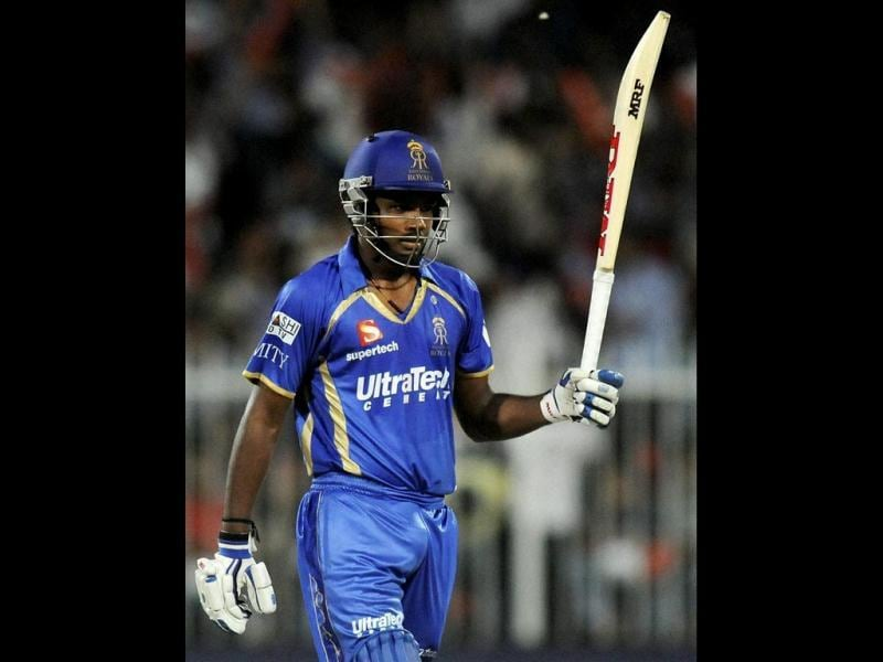 Sanju Samson of Rajatshan Royals raises his bat after scoring a half century during their IPL 7 match against Kings XI Punjab in Sharjah. (PTI Photo)