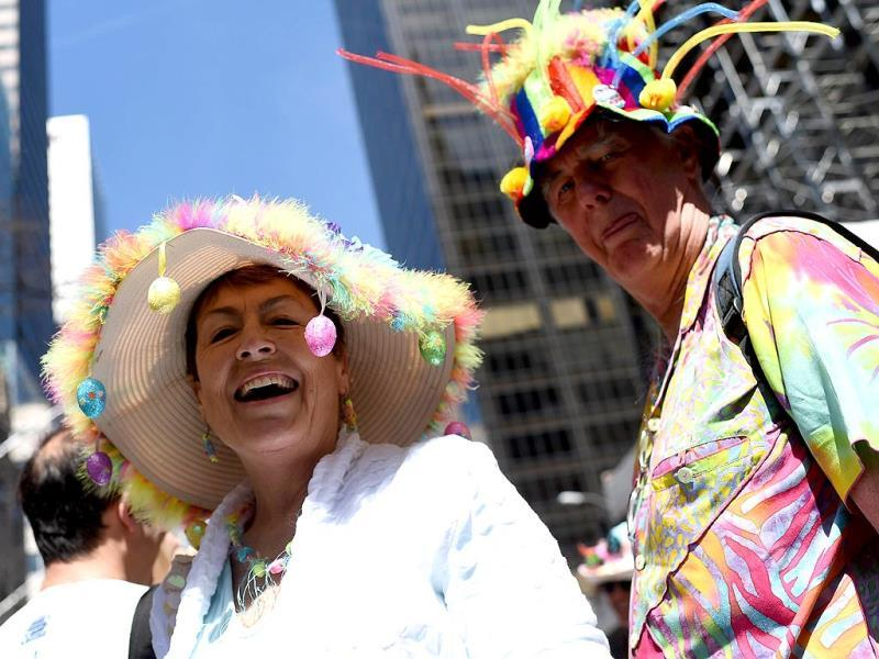 Participants pose in front of the camera to display their outfits during the annual Easter Parade. (AFP)