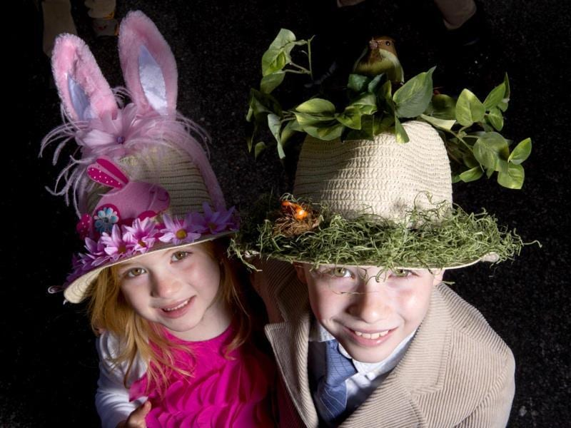 Youngsters Will and Sarah Lucas donned appropriately decorated hats for the annual Easter Parade and Bonnet Festival, which fills Fifth Avenue between 49th and 57th Streets, in New York, April 20, 2014. (Fred R. Conrad/The New York Times)