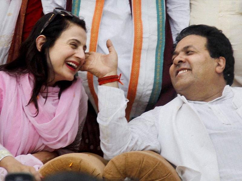 Amisha Patel with Congress senior leader Rajeev Shukla during an election campaign rally in Allahabad. (PTI Photo)