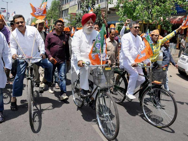 BJP leader SS Ahluwalia takes part in a bicycle rally during election campaign for party candidate Bijoya Chakraborty in Guwahati. (PTI photo)