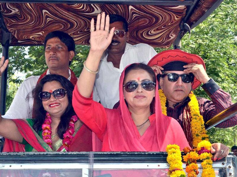 Actress and RLD leader Jaya Prada is seen at an election roadshow in support of party candidate Amar Singh in Fatehpur Sikri. (PTI photo)