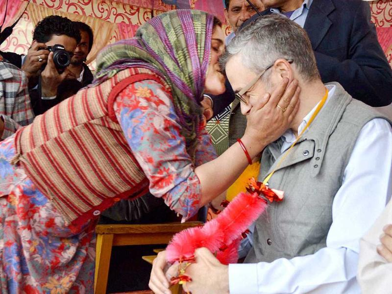 A supporter kisses CM of Jammu and Kashmir Omar Abdullah during an election rally in support of National Conference candidate Mehboob Beig at Damhaal Hanjipora in Kulgam district. (PTI photo)