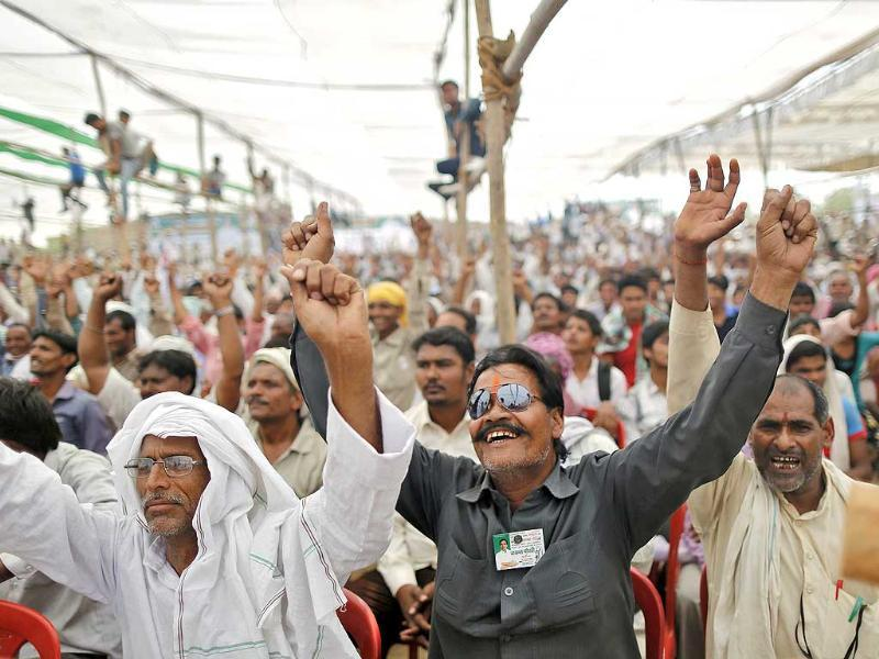 Congress supporters party cheer as they listen to Rahul Gandhi during an election campaign rally in Mathura. (Reuters photo)