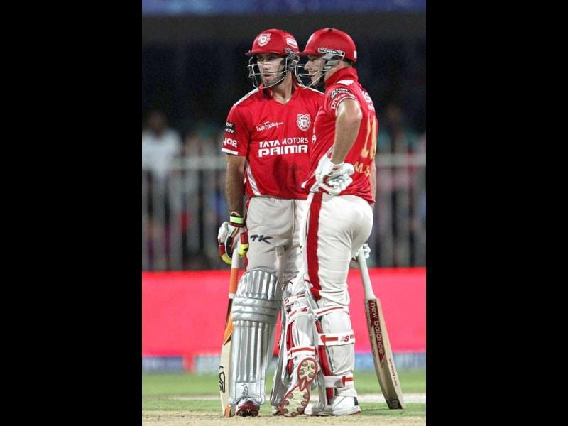 Kings XI Punjab players Glenn Maxwell and David Miller during their IPL 7 match against Sunrisers Hyderabad in Sharjah. (PTI Photo)