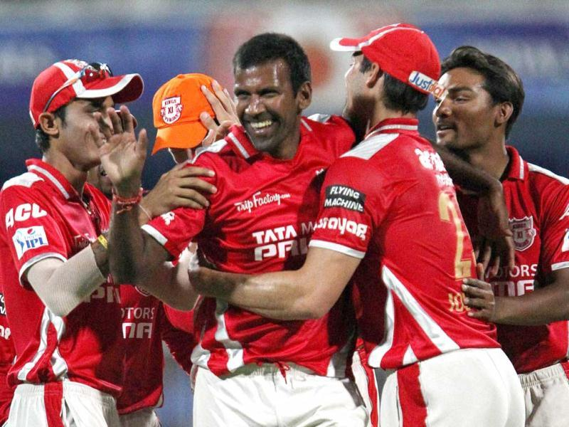 Lakshmipathy Balaji of Kings XI Punjab celebrates the wicket of David Warner of Sunrisers Hyderabad during their IPL 7 match in Sharjah. (PTI Photo)