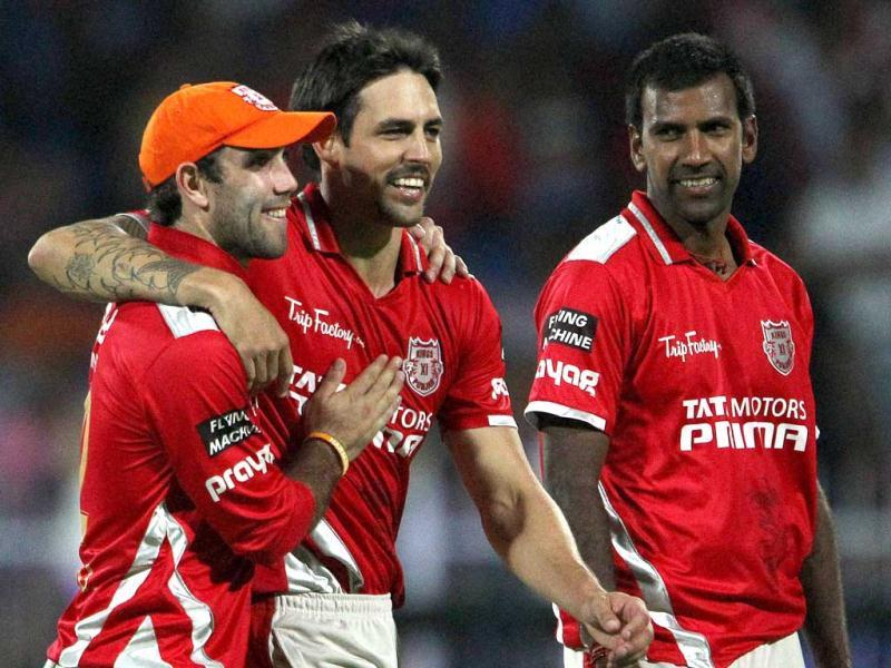 Glenn Maxwell of Kings XI Punjab with teammate Lakshmipathy Balaji celebrates the wicket of Karn Sharma of Sunrisers Hyderabad during their IPL 7 match in Sharjah. (PTI Photo)
