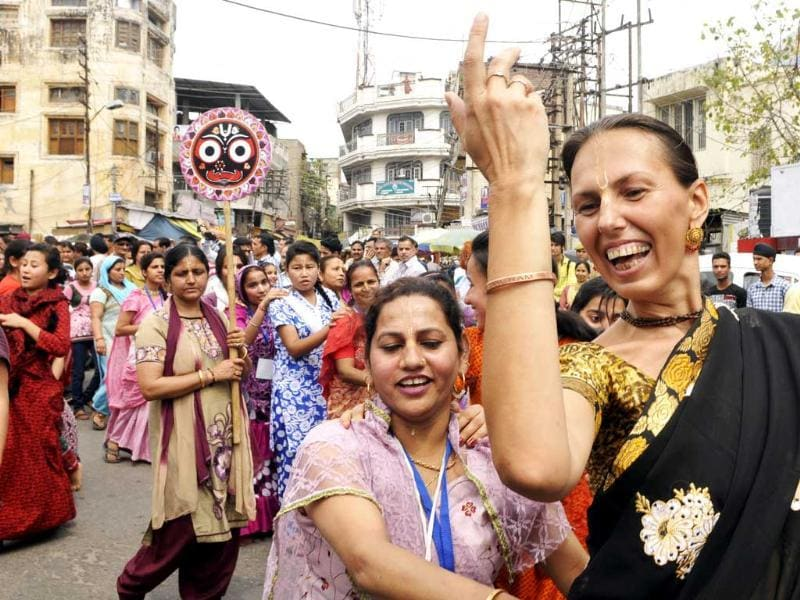 A foreigner lady along with Hindu devotees dance during the Jagannath Rath Yatra in Jammu, India. (HT photo/Nitin Kanotra)