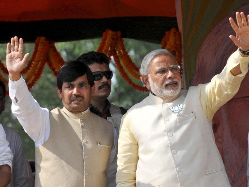 BJP's candidate from Bhagalpur, Shahnawaz Hussain, with Narendra Modi at an election rally in Bihar. (HT photo)
