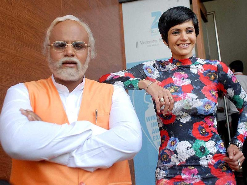 Bollywood actress Mandira Bedi and a Narendra Modi lookalike during promotion of the serial 'Gangs of Hasseepur' in Noida. (PTI photo)