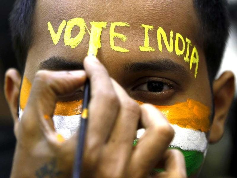 People get their face painted to create awareness on importance of voting at Dadar in Mumbai. (HT photo/Kunal Patil)