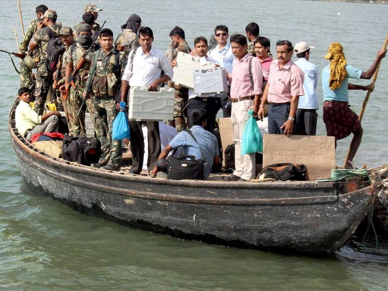 Polling parties leave for election duty by a boat on the eve of Lok Sabha elections in Malda district. (PTI photo)