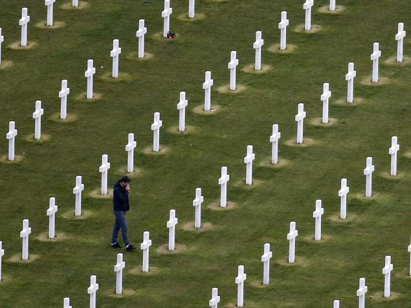 An aerial view shows a man walking among tombstones as he visits the World War II Normandy American Cemetery and Memorial at Colleville sur Mer, situated above Omaha Beach, in the Normandy region. (Reuters Photo)