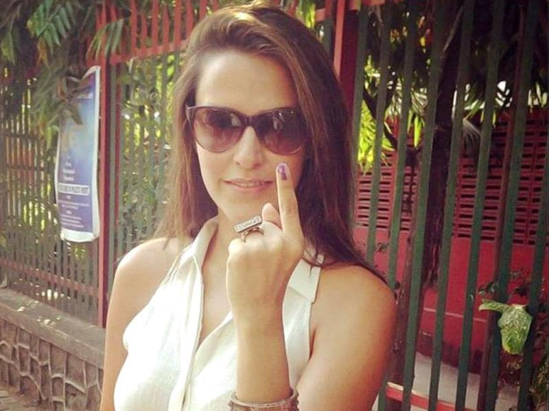 I also got inked! Neha Dhupia flaunts her finger after casting her vote.