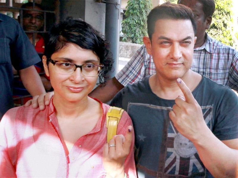 Bollywood actor Aamir Khan with his wife Kiran Rao after casting their vote in Mumbai on Thursday. (PTI)