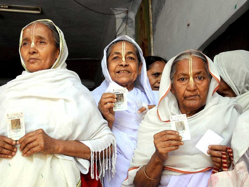 Widows standing in a queue to cast their votes for Lok Sabha polls at a polling booth in Vrindavan. (PTI photo)